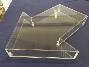Arrow shaped display case with removable back